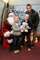 Pictured: Footballer Scott Sinclair (topR) meets young supporters in the grotto of Father Christmas. Thursday 15 December 2011<br />