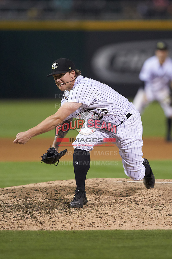 Charlotte Knights relief pitcher Robbie Ross Jr. (23) follows through on his delivery against the Indianapolis Indians at BB&T BallPark on May 26, 2018 in Charlotte, North Carolina. The Indians defeated the Knights 6-2.  (Brian Westerholt/Four Seam Images)