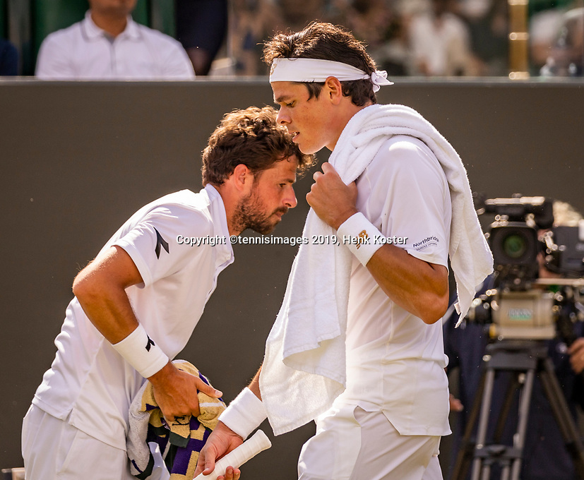 London, England, 3 July, 2019, Tennis,  Wimbledon, Robin Haase (NED) and Milos Raonic (CAN) (R) passing eachother during changeover<br /> Photo: Henk Koster/tennisimages.com