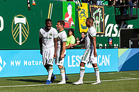 Portland, Oregon - Sunday October 6, 2019: Dairon Asprilla #27 celebrates scoring a goal with Sebastian Blanco #10 and Andy Polo #11 make it 2-1 Portland during a regular season match between Portland Timbers and San Jose Earthquakes at Providence Park in Portland, Oregon.