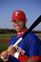 Texas Rangers first baseman Carlos Pena poses for a photo at the Charlotte County Sports Park in Port Charlotte, Florida during the spring of 1999.  (Ken Babbitt/Four Seam Images)