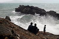 - a family admires the sea storm in the Tellaro village..- una famiglia ammira il mare mosso nel paese di Tellaro