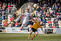 Jonathan Stead of Notts County shoots at goal under pressure from Danny Holmes of Newport County during the Sky Bet League 2 match between Newport County and Notts County at Rodney Parade, Newport, Wales on 30 April 2016. Photo by Mark  Hawkins / PRiME Media Images.