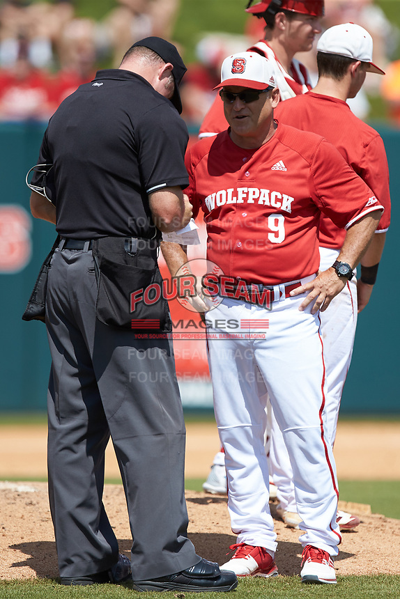 North Carolina State Wolfpack head coach Elliott Avent informs home plate umpire Mike Jarboe of a pitching change during the game against the Army Black Knights at Doak Field at Dail Park on June 3, 2018 in Raleigh, North Carolina. The Wolfpack defeated the Black Knights 11-1. (Brian Westerholt/Four Seam Images)