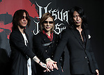 """July 25, 2016, Tokyo, Japan - Japanese visual-type rock singers Sugizo (L) of Luna Sea, Yoshiki (C) of X Japan and Takuro (R) of Glay pose for photo as they announced to have collaborated concert with other bands """"Visual Japan Summit 2016"""" in October at a press conference in Tokyo on Monday, July 25, 2016. The three-day concert will be supported by Japanese online commerce giant Rakuten.    (Photo by Yoshio Tsunoda/AFLO) LWX -ytd-"""