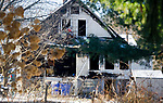 WATERTOWN, CT-122717JS02----Watertown fire department was called out Wednesday morning for a house fire at 25 Saugus Avenue in Watertown. The flames severely damaged the rear portion of the home. All three occupants were able to get out as well as the family dog. <br /> Jim Shannon Republican-American