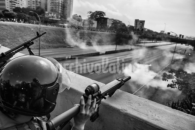 """National Guards during a failed  atempt to overthrow Nicolas Maduro in Caracas, April 30, 2019.  The guards were supporting   opposition leader Juan Guaidó, the president of the Venezuelan National Assembly who declared himself President.Guaidó appeared in an online video standing among heavily armed soldiers, calling for the military to back what he called the """"final phase"""" of an effort to topple Maduro's governmen, but the movement failed short after"""