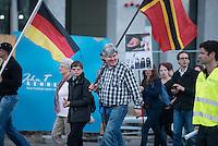 """Baergida Montagsdemonstration in Berlin.<br /> Ca. 150 Anhaenger des Berliner Pegida-Ablegers """"Baergida"""" zogen mit einer Demonstration vom Hauptbahnhof zum Roten Rathaus. Unter den Teilnehmern waren wie immer etwa 30-35 Fussball-Hooligans, sog. """"Reichsbuerger"""", Verschwoerungstheoretiker und Rechtsradikale. Die Demonstranten riefen immer wieder Parolen wie gegen anwesende Journalisten und gegen die Bundesregierung. Ein Journalist, der in der Vorwoche von Baergida-Anhaengern verpruegelt und verletzt wurde, wurde erneut verbal bedroht.<br /> Im Bild mit Fahne der rechtsradikalen """"German Defense League"""": Karl Schmitt, Initiator von Baergida und Patrioten e.V.<br /> 4.5.2015, Berlin<br /> Copyright: Christian-Ditsch.de<br /> [Inhaltsveraendernde Manipulation des Fotos nur nach ausdruecklicher Genehmigung des Fotografen. Vereinbarungen ueber Abtretung von Persoenlichkeitsrechten/Model Release der abgebildeten Person/Personen liegen nicht vor. NO MODEL RELEASE! Nur fuer Redaktionelle Zwecke. Don't publish without copyright Christian-Ditsch.de, Veroeffentlichung nur mit Fotografennennung, sowie gegen Honorar, MwSt. und Beleg. Konto: I N G - D i B a, IBAN DE58500105175400192269, BIC INGDDEFFXXX, Kontakt: post@christian-ditsch.de<br /> Bei der Bearbeitung der Dateiinformationen darf die Urheberkennzeichnung in den EXIF- und  IPTC-Daten nicht entfernt werden, diese sind in digitalen Medien nach §95c UrhG rechtlich geschuetzt. Der Urhebervermerk wird gemaess §13 UrhG verlangt.]"""