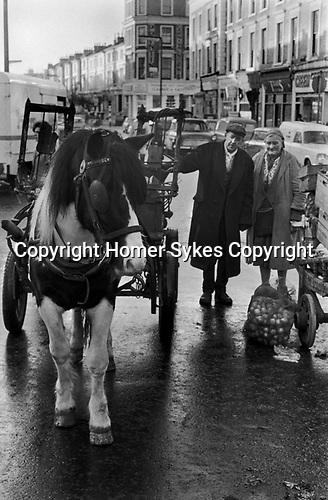 Rag and Bone Man, and wife / partner.she runs a market stall selling fresh vegetables etc  horse and collecting scrap metal and stuff to sell, Ladbroke Grove West London 1970
