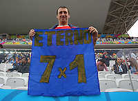 An Argentina supporter holds a banner with the result of last night's Germany vs Brazil semi final, 7-1
