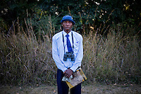 """18 year old Ian Mukabe from Kafinda basic school in Sereje district, on his first safari in Kasanka National Park. """"Because wildlife is very nice I hope and trust to do the job of conservation,"""" Ian said. """"I'm interested in conservation. The value of animals is that they bring visitors from other countries. Kasanka NP has attracted people - they come to watch the animals. To local people, animals provide us with food and other things which we can use as well."""" Local schools and women's groups are regularly brought into Kasanka, which is unique in the country and unusual in Africa as it is privately managed and owned by a trust. People are able to see animals flourishing in land which was once free reign for poachers. Combined with anti-poaching scouts, the education programme is on the frontline of conservation methods in the park, showing local people wild animals in their natural habitat."""