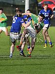 Naomh Mairtin Thomas Sullivan Sean O'Mahony's Liam Donlon. Photo:Colin Bell/pressphotos.ie