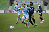 6th June 2021; AAMI Park, Melbourne, Victoria, Australia; A League Football, Melbourne Victory versus Melbourne City; Naoki Tsubaki of Melbourne City holds off the challenge from Adama Traore of the Victory