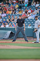 First base umpire Nate Tomlinson handles the calls on the bases during the game between the Salt Lake Bees and the El Paso Chihuahuas at Smith's Ballpark on August 14, 2018 in Salt Lake City, Utah. El Paso defeated Salt Lake 6-3. (Stephen Smith/Four Seam Images)