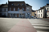 Team Sky passing through a french village on their way to the next cobbled sector<br /> <br /> 2015 Paris-Roubaix recon with Team SKY