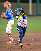Michigan Wolverines outfielder Lyndsay Doyle (11) on the bases during the season opener against the Florida Gators on February 8, 2014 at the USF Softball Stadium in Tampa, Florida.  Florida defeated Michigan 9-4 in extra innings.  (Copyright Mike Janes Photography)