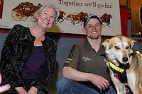 """Dallas Seavey's lead dog """"Reef"""" receives the City of Nome Lolly Medley Golden Harness award from Nome Mayor Denise Michaels at the finishers banquet in Nome on Sunday  March 22, 2015 during Iditarod 2015.  <br /> <br /> (C) Jeff Schultz/SchultzPhoto.com - ALL RIGHTS RESERVED<br />  DUPLICATION  PROHIBITED  WITHOUT  PERMISSION"""