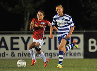 20130906 - OOSTAKKER , BELGIUM : Gent's Margaux Van Ackere pictured with PSV Danielle Van De Donk (left) during the female soccer match between AA Gent Ladies  and PSV / FC Eindhoven Dames , of the third matchday in the BENELEAGUE competition. Friday 06 th September 2013. PHOTO DAVID CATRY