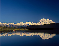Canoeists, Mount McKinley and Wonder Lake, Denali National Park, Alaska.  Sept.