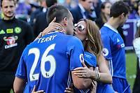 John Terry of Chelsea gets a kiss from his wife after an emotional farewell speech to the Chelsea supporters after lifting the Premier League Trophy after his last Premier League match following the EPL - Premier League match between Chelsea and Sunderland at Stamford Bridge, London, England on 21 May 2017. Photo by David Horn.