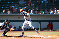 Salt River Rafters center fielder Monte Harrison (4), of the Miami Marlins organization, at bat during an Arizona Fall League game against the Mesa Solar Sox at Sloan Park on November 9, 2018 in Mesa, Arizona. Mesa defeated Salt River 5-4. (Zachary Lucy/Four Seam Images)