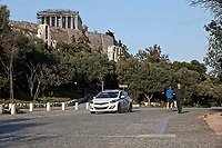 Pictured: Police patrol the area around the Acropolis.<br /> Re: Police patrol the streets to enforce the measures of self-isolation in an effort to fight the Coronavirus Covid-19 pandemic in Athens, Greece.