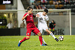 Roberto Orlando Affonso Junior of Hong Kong (L) fights for the ball with Alsamarneh Obida of Jordan (R) during the International Friendly match between Hong Kong and Jordan at Mongkok Stadium on June 7, 2017 in Hong Kong, China. Photo by Cris Wong / Power Sport Images