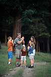A family of five enjoy a hiking game on a trail in Rocky Mtn Nat'l Park, CO