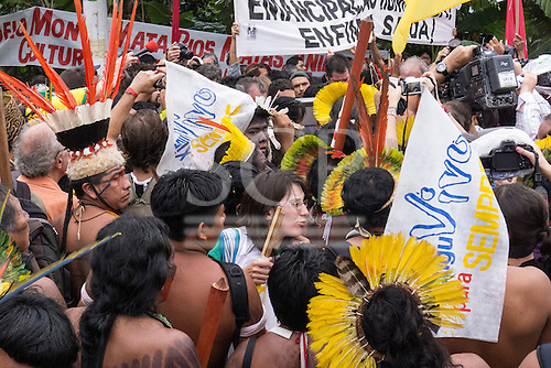 indigenous people demonstrate carrying Xingu Vivo Para Sempre (Xingu Alive Forever) banners to protest against the construction of the Belo Monte hydroelectric dam at a demonstration by indigenous people, the Landless People's Movement (MST) and other civil society groups in front of the Riocentro United Nations conference. The demonstrators are kept out of earshot and invisible to the UN conference. United Nations Conference on Sustainable Development (Rio+20), Rio de Janeiro, Brazil, 20th June 2012. Photo © Patrick Cunningham.