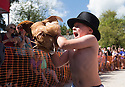 06/08/16<br /> <br /> ***WITH VIDEO***<br /> <br /> Brody Wordsworth, 6, struggles to hold his hen before the start of the first heat..<br /> <br /> Crowds cheer on hens as they compete at the World Hen Racing Championship outside the Barley Mow pub in Bonsall near Matlock Bath, in the Derbyshire Peak District.<br /> <br /> All Rights Reserved, F Stop Press Ltd. +44 (0)1773 550665