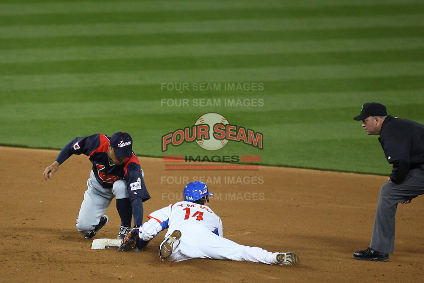 Akinori Iwamura of Japan tags out Young Min Ko of Korea at second base during the World Baseball Classic at Dodger Stadium on March 23, 2009 in Los Angeles, California. (Larry Goren/Four Seam Images)