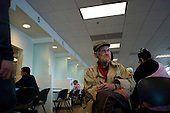 Los Angeles, California<br /> January 31, 2014<br /> <br /> 85 yr old, former homeless WWII veteran Ivan Bennett, who just one week earlier was placed in the permanent  HUD Vash housing with a voucher is taken out to the Social Security office by VA case workers William Kurts and Veronica Fraga. Ivan is one of more then 950 homeless veterans placed in housing since last year.