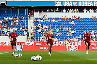 United States (USA) goalkeeper coach Paul Rogers, goalkeeper Jill Loyden (21), and goalkeeper Hope Solo (1) during warmups. The women's national team of the United States defeated the Korea Republic 5-0 during an international friendly at Red Bull Arena in Harrison, NJ, on June 20, 2013.