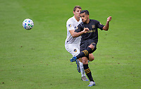 LOS ANGELES, CA - OCTOBER 25: Mohamed El-Munir #13 of LAFC moves to the ball during a game between Los Angeles Galaxy and Los Angeles FC at Banc of California Stadium on October 25, 2020 in Los Angeles, California.