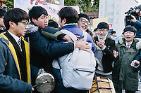 Junior students braved the cold weather and gathered at the gate of Yongsan High School in Seoul to cheer their seniors before this year's suneung, Korea College Entrance Exam. Examinees on their way in were greeted with drums and gongs, sweets, and messages of support.