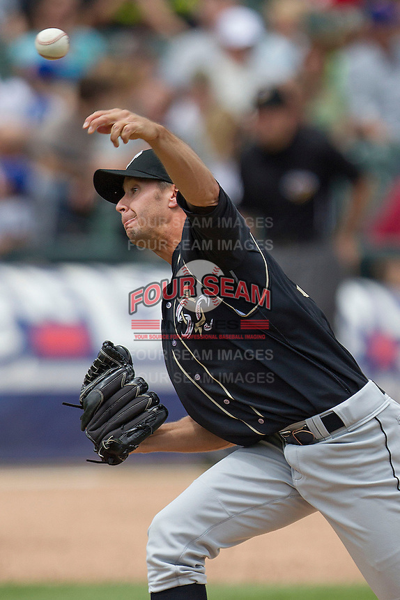 Omaha Storm Chasers pitcher Everett Teaford #25 delivers a pitch to the plate against the Round Rock Express in the Pacific Coast League baseball game on April 7, 2013 at the Dell Diamond in Round Rock, Texas. Omaha beat Round Rock 5-2, handing the Express their first loss of the season. (Andrew Woolley/Four Seam Images).