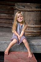 Estonia, Muhu Island. Muhu Jaanalind, guest house and farm. Little girl.