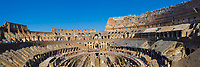 Panorama of the arena and hypogeum inside the famous Ancient Roman Colosseum (Flavian Amphitheatre) under a blue sky, in Rome Italy, Southern Europe