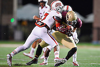 Texas State wide receiver Brice Gunter (88) is tackled by Louisiana Lafayette cornerback Corey Trim (7) during first half of an NCAA football game, Tuesday, October 14, 2014 in San Marcos, Tex. Louisiana Lafayette leads 21-3 at the halftime. (Mo Khursheed/TFV Media via AP Images)