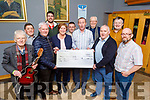 Staff from the An Post Carol Singing presented the sum of €1,700 to Down Syndrome Kerry in the Kerins O'Rahilly club on Saturday.<br /> Front l to r: Michael Gaffney, Kevin Griffin (Chairman of Down Syndrome Kerry), Grace O'Donnell (321 Down Syndrome Shop), Mikey Wall (An Post), Martin Farrell (An Post), Ted Murphy (An Post), Danny Roche, Alan O'Sullivan (An Post), John Joy (An Post), Paddy O'Riley (An Post) and Bill O'Sullivan (An Post).