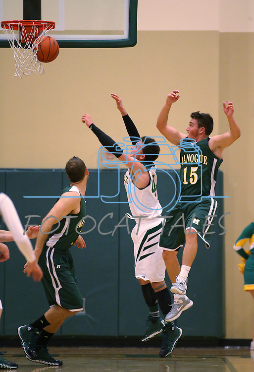 Manogue's Remy Dillard shoots against Alumni defenders Thomas Peregrin and Keith Fuetsch during the alumni game at the Wild West Shootout at Bishop Manogue High School in Reno, Nev., on Wednesday, Dec. 4, 2013. The Miners defeated the alumni 79-62. <br /> Photo by Cathleen Allison