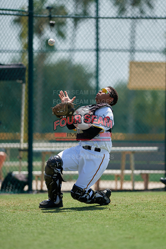 GCL Pirates catcher Gabriel Brito (15) slides to try to catch a pop up during a game against the GCL Braves on July 26, 2017 at Pirate City in Bradenton, Florida.  GCL Braves defeated the GCL Pirates 12-5.  (Mike Janes/Four Seam Images)