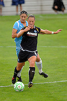 Brittany Bock (11) of the Los Angeles Sol is chased by Yael Averbuch (10) of Sky Blue FC. Sky Blue FC and the Los Angeles Sol played to a 0-0 tie during a Women's Professional Soccer match at Yurcak Field in Piscataway, NJ, on June 13, 2009.