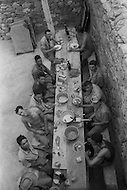 """Mascara Area, Algeria, Summer 1961. Typical French Fort for a small harka unit. This unit counted 48 """"harkis"""", Arab origin, fighting along the French troops. Harkis during lunch time."""