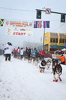 Lance Mackey and team leave the ceremonial start line at 4th Avenue and D street in downtown Anchorage during the 2013 Iditarod race. Photo by Jim R. Kohl/IditarodPhotos.com