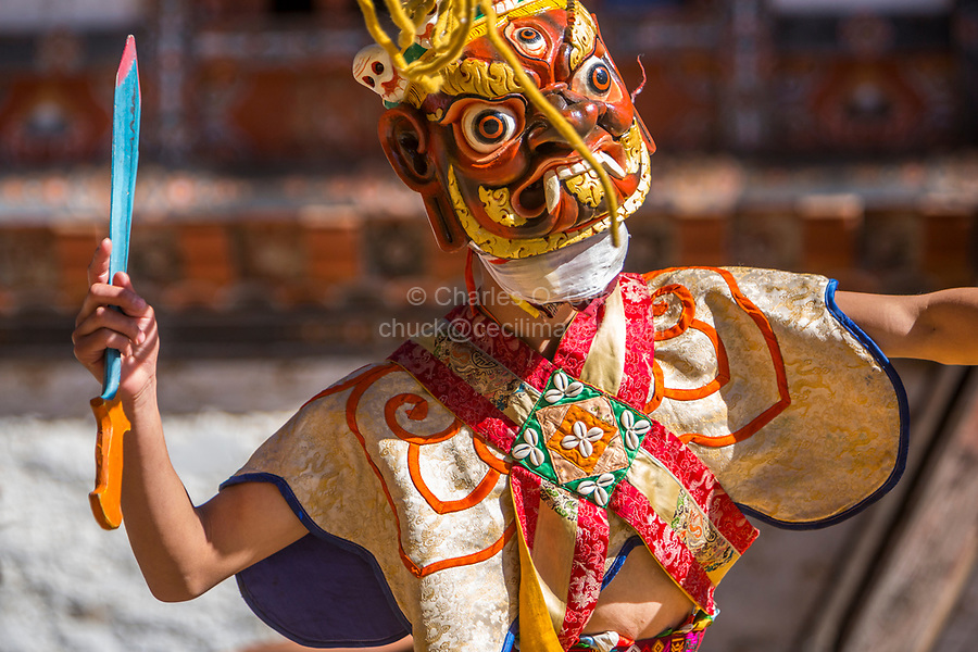 Prakhar Lhakhang, Bumthang, Bhutan.  Buddhist Monk Wearing Mask of a Mythological Deity while Performing a Dance in the Duechoed Religious Festival.