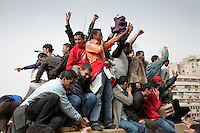 Young protesters stand on top of a tank in Tahrir Square. Continued anti-government protests take place in Cairo calling for President Mubarak to stand down. After dissolving the government, Mubarak still refuses to step down from power. .