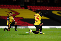 Étienne Capoue of Watford takes a knee during the Sky Bet Championship behind closed doors match played without supporters with the town in tier 4 of the government covid-19 restrictions, between Watford and Norwich City at Vicarage Road, Watford, England on 26 December 2020. Photo by Andy Rowland.