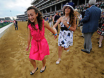 John R. Velasquez's daughter Lerina (pink) celebrates her father's win aboard Animal Kingdom, trained by Graham Motion,in the 137th running of the Kentucky Derby at Churchill Downs in Louisville, Kentucky on May 7, 2011.