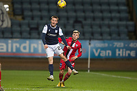 27th March 2021; Dens Park, Dundee, Scotland; Scottish Championship Football, Dundee FC versus Dunfermline; Jordan Marshall of Dundee heads clear from Fraser Murray of Dunfermline Athletic